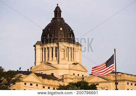 Sunrise lights up the capitol dome in Pierre SD