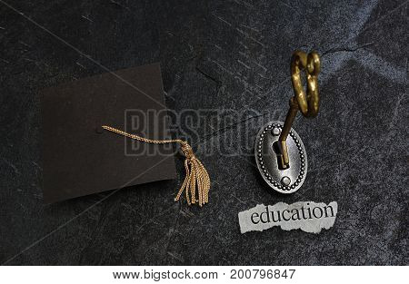 Gold key opening education lock and graduation cap