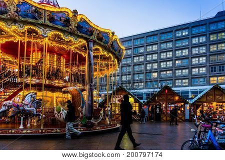 BERLIN, GERMANY - DECEMBER 23, 2016: decorated booths and christmas lights at Gendarmenmarkt Christmas Market.