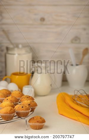 Kitchen utensils tools and products for the capcake (muffins) on a light wooden background. Selective focus.