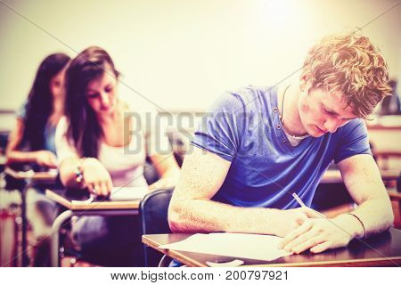 Students having a test in classroom