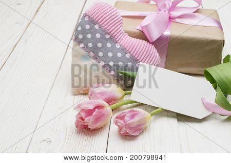 beautiful tulips with gift box. happy mothers day, romantic still life, fresh flowers. on wooden background