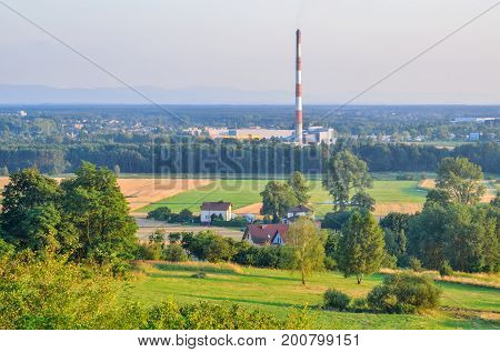 Summer countryside industrial landscape. Homes in the countryside and industrial factories.