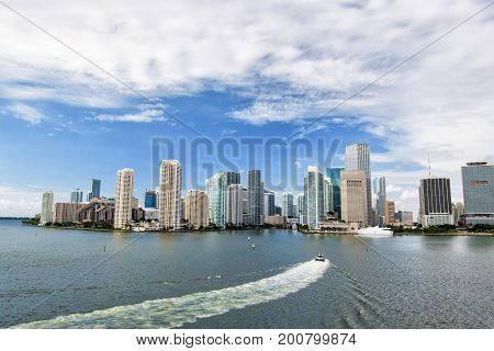 Miami skyline skyscrapers yacht or boat sailing next to Miami downtown Aerial view south beach