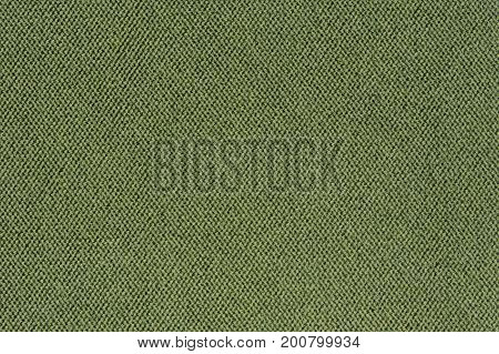 A close-up of green fabric texture as a background