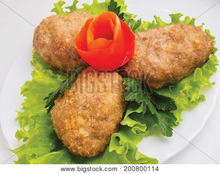 Beef Cutlets With Greens And Vegetables On The Plate