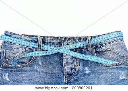 Jeans Top Part With Measure Tape Solated On White Background