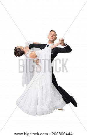 dance ballroom couple in a dance pose isolated on white background. sensual professional dancers dancing walz tango slowfox and quickstep.