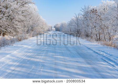 Winter landscape with slippery country road in Dnepropetrovskaya oblast Ukraine