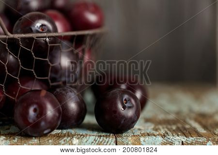 Ripe plums on a dark background. Macro photo. Selective focus.