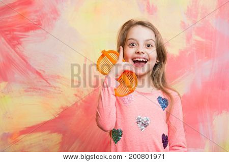 Happy Girl Having Idea On Colorful Abstract Wall