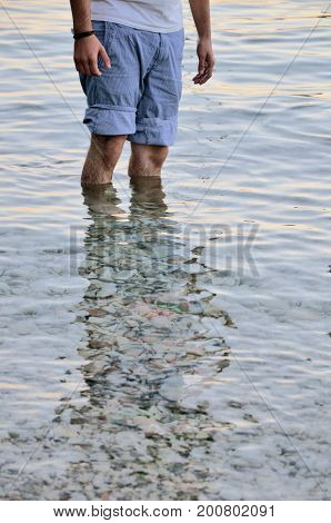 man legs in water close up photo