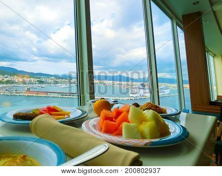 Palma de Mallorca, Spain - September 07, 2015: The main restaurant at Royal Caribbean, Allure of the Seas at Barselona on September 6, 2015. The view through the glass of the restaurant inside the ship