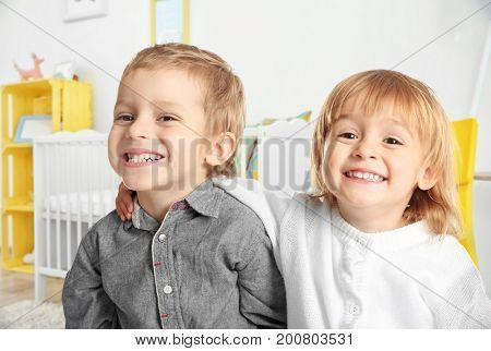 Cute little kids in children's room