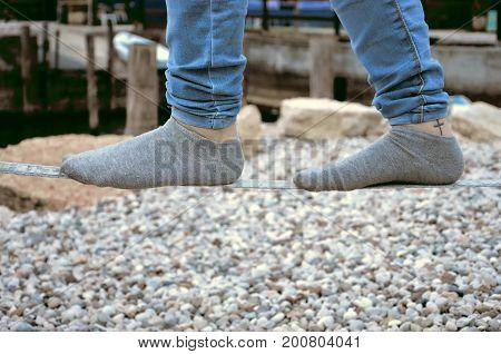 slacklining a man wih socks close up photo