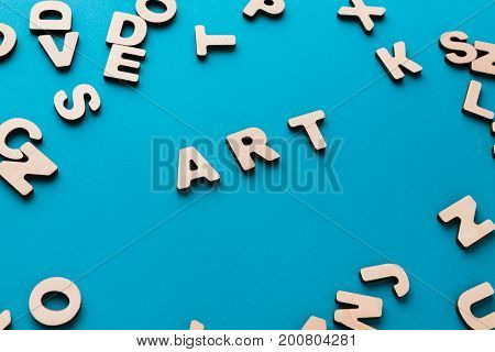 Word Art on blue background, in wooden letters frame. Creativity, craftsmanship, modern life concept poster