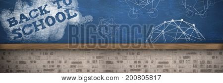 Back to school text on green and blue splash against bueboard on brick wall