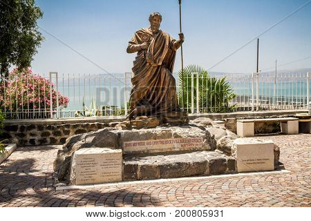 CAPERNAUM ISRAEL - MAY 15: Sculpture of St. Peter the Apostle of bronze in Archaeological site on the shore of the Sea of Galilee in Capernaum Israel on May 15 2017