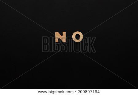 Word No on black background. Refusal, denial, negation concept