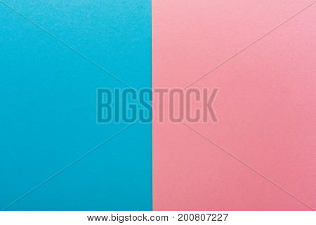 Blue and pink contrast background, copy space. Sex differences, baby gender concept
