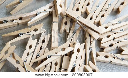 many wooden clothespin on a gray background