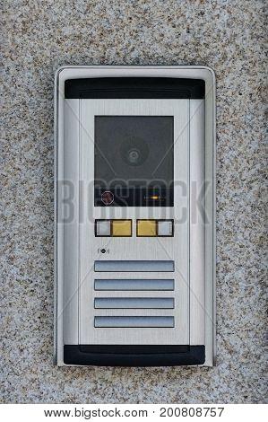 image of intercom on the wall close up