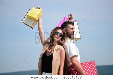 Sexy Girl And Guy With Happy Faces Make Purchases