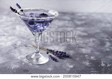 martini with berries on the dark stone background, copy space