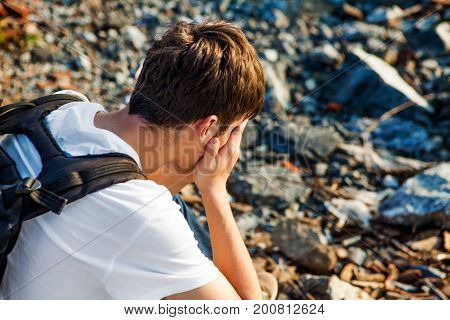 Side View of Sad Young Man outdoor