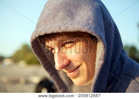 Young Man Portrait in the Hood outdoor