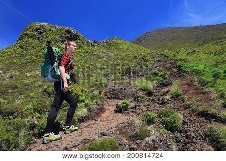 Young woman trekking on Pico volcano, Pico Island, Azores, Portugal, Europe