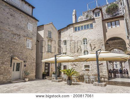 SPLIT, CROATIA - JULY 12, 2017: Ancient stone buildings on the streets of Split in Croatia.