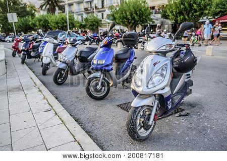 MAKARSKA RIVIERA, CROATIA - 10 JULY, 2017: Mopeds in the city parking. In the resort cities of Croatia, a moped is one of the most popular themes with vehicle rental.