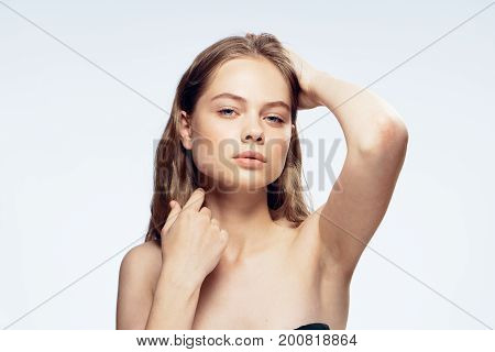 Beautiful young woman on white isolated background, portrait.
