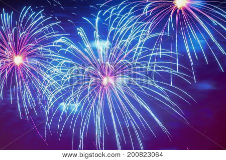 Close-up of vivid blue fireworks with sparks. Explosive pyrotechnic devices for aesthetic and entertainment purposes, art. Colored fireworks, holiday backdrop
