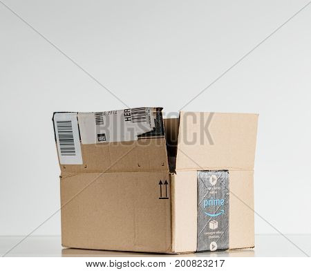 PARIS FRANCE - JUL 30 2017: Open Amazon Prime logotype printed on cardboard box side. Amazon is an American electronic e-commerce company distribution worlwide e-commerce goods