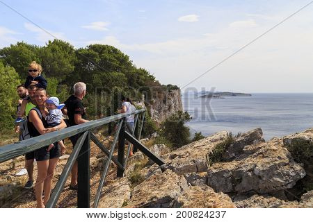 DUGI OTOK, CROATIA - SEPTEMBER 7, 2016: Unknown tourists are on the observation deck on coastal cliffs of the island in Telascica Nature Park.