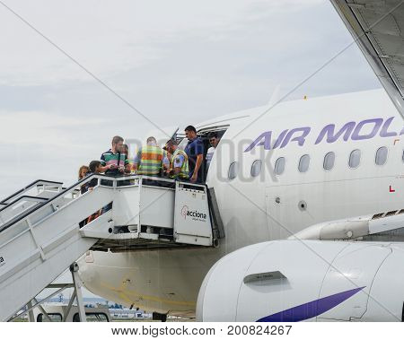 FRANKFURT GERMANY - AUG 8 2017: German police Polizei and Zoll Customs workers inspecting the passengers passports of Air Moldova Airbus aircraft on the airstair before descending - searching for illegal migrations and terrorists - Frankfurt International
