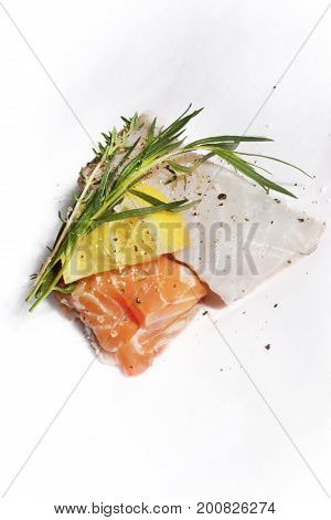 Fishes fillets, lemon and herbs for cooking