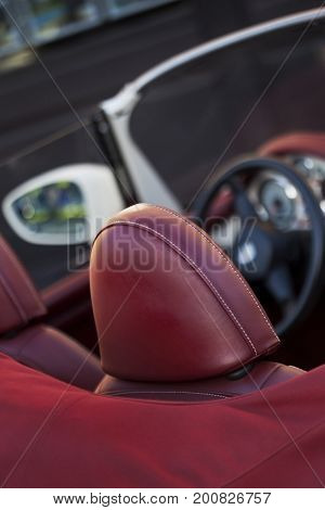 Red leather seats in a stylish convertible car