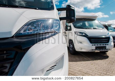 Brand New Camper Vans For Sale on Dealer Lot. Camping and Travel Industry.