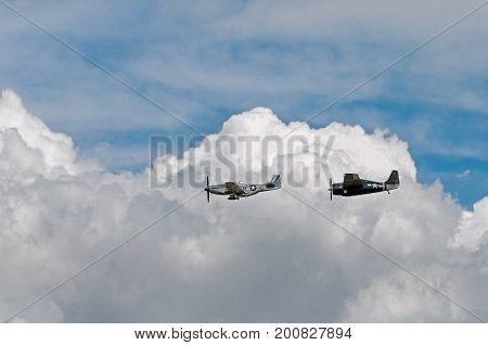 EDEN PRAIRIE MN - JULY 16 2016: P-51 Mustang Sierra Sue II and FM-2Wildcat at air show. Used primarily in WWII the Mustang was a long-range fighter while the Wildcat was involved in convoy protection.