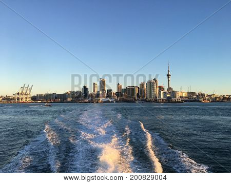 Auckland from the harbour during sunset, taken on a ferry