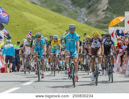 Col du Lautaret France - July 19 2014: The peloton arrives on Col du Lautaret in Hautes Alpes during the stage 14 of Le Tour de France 2014.