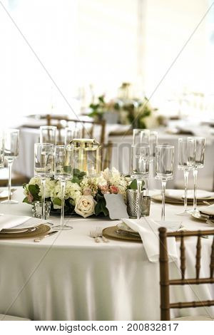 Elegant place settings at outdoor wedding reception