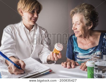 Doctor explains to elderly daily dose of medication