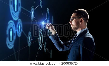 business, augmented reality and human resources concept - businessman with virtual network contacts over black background