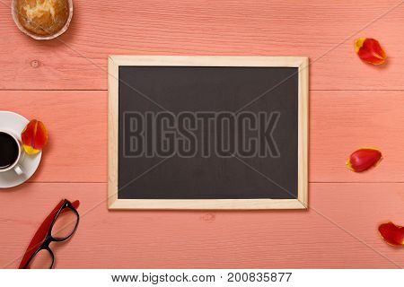 Office wooden desk table with coffee cup. Top view with copy space on workplace. View from above with copy space for post blog social media. Background for banner template, layout, mockup.