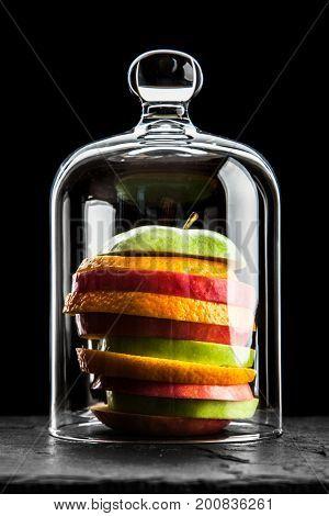 Fruit slices on black background