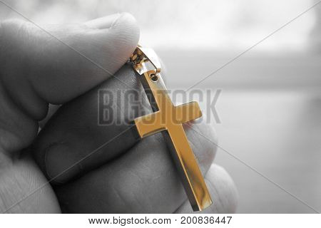 Golden Cross In Hand With Black & White Background High Quality